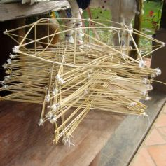 Making Lao Star lanterns from bamboo and string.